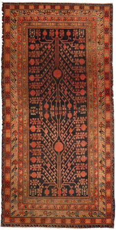A Samarkand carpet BB4291 - An early 20th century Samarkand (Khotan) antique rug, the black field with a highly structured symmetrical red ...