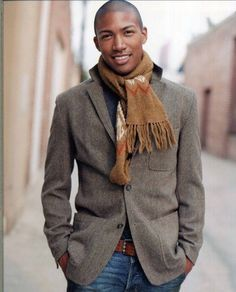 Shop this look for $175:  http://lookastic.com/men/looks/belt-and-jeans-and-crew-neck-sweater-and-scarf-and-blazer/1684  — Brown Leather Belt  — Navy Jeans  — Navy Crew-neck Sweater  — Tobacco Scarf  — Charcoal Wool Blazer