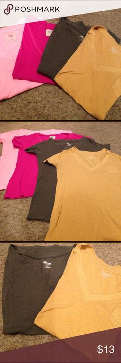 🐾V neck bundle (4) Short sleeved gently used v neck tees.                         2 Hollister salmon and hot pink. These fit on the looser side like a large medium.                                      2 Mossimo olive and mustard. These fit a lot more fitted. Mossimo Supply Co. Tops Tees - Short Sleeve