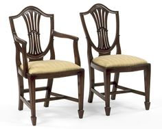 Style #FSFI-2-Sheraton style shield back with carved inverted V design arm chair and side chair. Shown in mahogany.