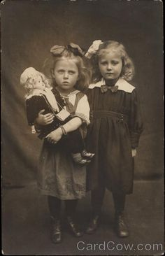 Portrait of Sisters with Doll Girls