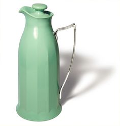 "This elegant jug is marked ""Thermos (1925) Limited – London"", but patents for the vacuum system design were registered in 1930. 1925 is possibly the year the American Thermos Bottle company was established in UK. It was molded from Plaskon (urea formaldehyde) plastic, with metallic handle. Thermos produced a number of amazing designs. It is 24,5cm high."