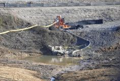 In this Thursday, Jan. 14, 2016, photo, a drainage pipe that was the original culprit of the coal ash spill is shown at the Dan River Steam Station in Eden, N.C. Duke Energy Corp. is digging up and hauling away from riverbanks the toxic coal residues two years after one of the worst coal-ash spills in U.S. history. (AP Photo/Gerry Broome)