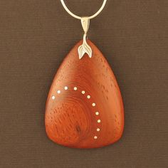 Padauk Pendant with Silver Inlaid Dots by CurvitureStudio on Etsy, $44.00