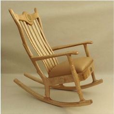 This custom solid hardwood upholstered seat rocking chair is made from a figured sugar maple tree.