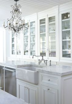 An elegant white kitchen! Part of StyleBlueprint's 17 Beautiful White Kitchens on StyleBlueprint. Each of these kitchens features white cabinets and will make you swoon!