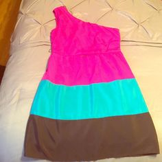 Multi-Color Cocktail Dress Very cute one shoulder cocktail dress in fuchsia teal and brown. Worn once. Looks really cute with a belt. In great condition. Side zipper. 100% cotton. Size medium Dresses Mini