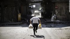 Syrian man running from sniper fire on way home from syore