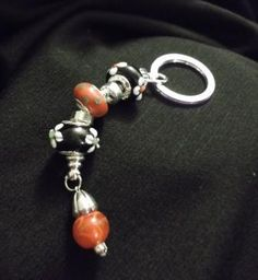 """Murano Glass beads and Silver plated key chain accented with Tibetan Silver finding and glass bead.  4"""" including 1"""" key ring.   TopHatter Auction March 6,12 @ 2 pm pst"""