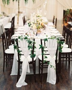 Leafy vines and wispy fabric marked these newlyweds' spots