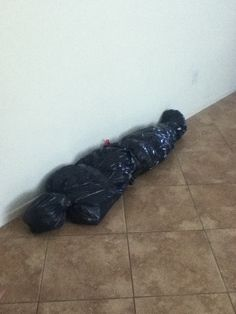 "This will be hanging at the front door Halloween night with a sign next to the candy bowl. ""take one candy please or you will be next years Halloween prop. :) happy Halloween!"". Black garbage bags stuffed with newspaper. Tape or tie to mold in body shape."