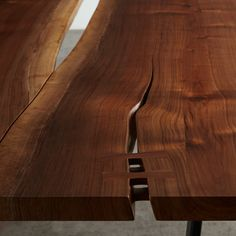 This walnut reverse matched table top with center reveal is shown with a black steel sled base. This tree was salvaged in Salem, Oregon.