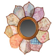 Wall mirror with petal collage frame.  Product: MirrorConstruction Material: Mirrored glass and metalColo...