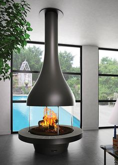 Central wood design fireplace on stand ALEXIA 995 Floating Fireplace, Metal Fireplace, Freestanding Fireplace, Home Fireplace, Modern Fireplace, Fireplace Design, Propane Fireplace, Fireplace Ideas, Wood Burning Logs