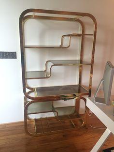 Vintage brass bookcase