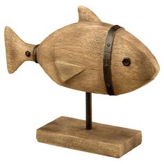 Add a charming touch to your kitchen counter or entryway console table with this rustic fish statuette, showcasing a weathered finish and metal accents.