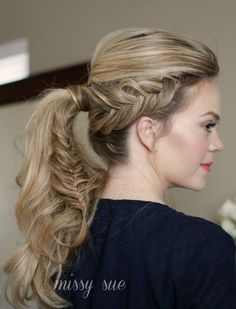 dutch fishtail ponytail - notice how it is pulled out for a messier look.