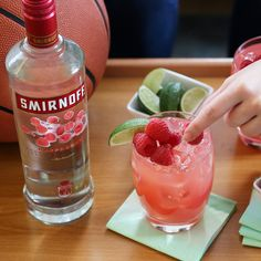 RASPBERRY BUZZER BEATER. The easiest way to win the basketball playoffs without ever getting in the game.   Just mix 1.5oz Smirnoff Raspberry, 3oz Cranberry Juice and  a splash of Orange Juice.