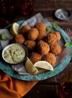 Crispy fried roasted tomato risotto balls with smoked mussels.