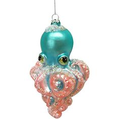 Display your holiday spirit with Brighten the Season home accents & decor. This glittery and colorful glass octopus ornament is sure to bring coastal ch...