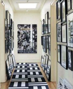 My vision for our hallway. Black and white striped rug. Gallery frames in black with white mats.