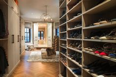 California Closets' design consultant Jennifer Lavoie collaborated closely with Marigay and Nicole on every custom detail. The goal: to create a modern, boutique-like environment that would tastefully organize Marigay's clothing and accessories, while respecting the original architecture of the space and carving out a comfortable yet compact Gentleman's Closet within the space for her partner.  #customcloset #walkincloset #shoes #clothes #style #stylist #organize #interiordesing