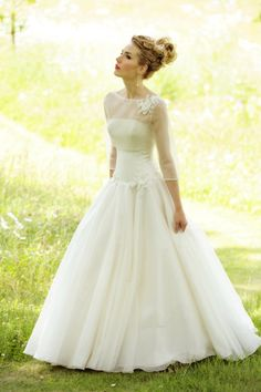 I like the idea of pockets in the wedding dress.. im not much of a purse person. Im not sure but it looks like the sheer sleaved top part is sepperate from the dress. I like the idea of being more concertive at the church service and it also gives your dress almost two looks when removed for the reception.