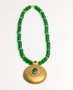 Green jade necklace and matching polymer clay pendant .
