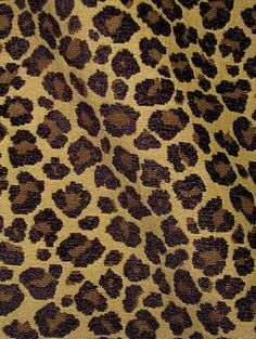 """Phat Cat Godiva.  Cheetah tapestry fabric with chenille accent. thick and soft multi purpose fabric. 54"""" wide."""