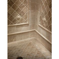 """Idea for shower tile design.  Mosaic 2"""" Noce on the shower floor with 6"""" Chiaro border and with 4"""" Noce tumbled marble inset on walls."""