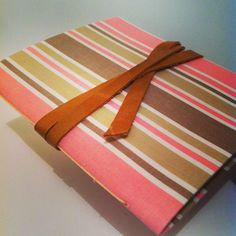 Fabric covered #journal with #leather stripe closure #gabirobacrafty #handbound
