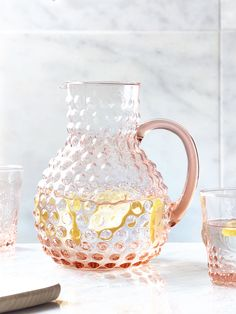 Crafted from quality glass with an embossed textured bubble finish, our weighty blush pitcher features a bowl shaped base, elegant funnel neck and large ergonomic handle. The perfect match for our Two Embossed Glasses- Blush, this stylish pitcher is ideal for creating your favourite cocktail or cordial. Also available inGreyand Clear.