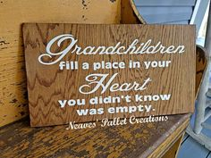 """RECYCLED PALLET WOOD:  This sign is for some very special Grandparents. This sign is 20"""" x 11"""" and we stained the background, painted the phrase in white, and then added a coat of poly over the entire sign. We asked $18 for it. It comes with a hanger of your choice. (Burlap ribbon, rusty wire, or """"D"""" hooks.) Message us if you want to order one for your parents. We could even do one for those Greatgrands.   Item# 1,487"""