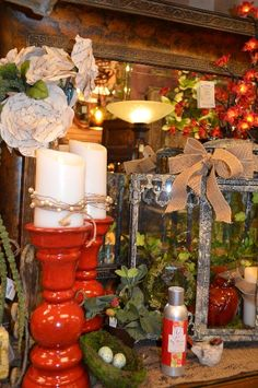 This lantern is accented with a Luminara candle that keeps a red cardinal company.  Topped by a sweet, natural ribbon that matches the ribbon around the candle.