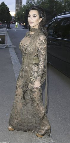Making her entrance: Kim certainly turned heads as she arrived at the star-studded London event