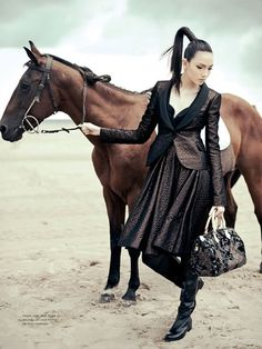 This is how NOT to hold a horse. And I doubt that girl is going to go riding in that outfit... One of my biggest pet peeves, is when they try to sell non-horse clothes with a horse.