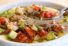 posole recipe garnished with diced tomato and avocado (serve with warm flour tortillas) | from use real butter