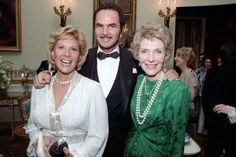 FIRST LADY NANCY REAGAN greets DINAH SHORE and BURT REYNOLDS in the Blue Room of The White House during a state dinner for Premier Zhao Ziyang of the Peoples Republic of China; January 1984.