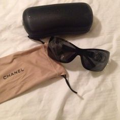 Authentic Chanel Sunglasses I loved these glasses and they have stayed in beautiful shape because I babied the heck out of them. No scratches on the glasses. I'll include the drawstring pouch and case. The case did its job protecting my glasses and has marks on and inside of it. CHANEL Accessories Sunglasses