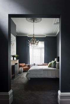 A Moody, Masculine Home for an Australian Philanthropist | Interior Design by Charles Prior of Baxter Creative | Photography by Shannon McGrath | Modern Sanctuary | Bedroom | Modern Bedroom | Gray Bedroom | Lighting | Bedding