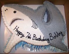 This Shark Cake was free cut and the pieced together, frosted with butter cream.  She give some details.  I love the shape!