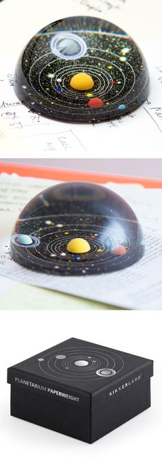Crystal clear acrylic and a fascinating model of the solar system that prevents your important papers from taking flight from your desk. #colossal