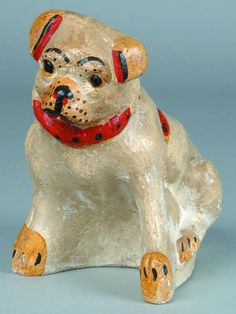 """Sold For $ 60                                                          Chalkware Bulldog Form Coin Bank, hollow cast, painted with red, yellow and black highlights, coin slot at top of back, 7-¼""""h. x 5-½""""w., (discolorations)."""
