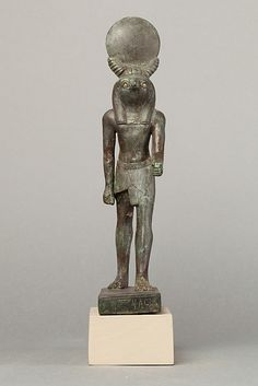 An ancient base asking blessings from theka for the Scribe of the Library of Atum Pa-kap, son of the Prophet of Atum Pa-iry-kap and the mistress of the House Hr-ib-Wadjet; above the ankles the statuette is brass and therefore modern  Period: Late Period and Modern Date: 664-332 B.C. and Modern Geography: Egypt Medium: Bronze, precious metal inlay