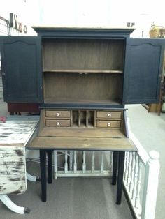 $153 - This vintage drop front secretary desk has 4 small drawers and cubbie inside. Double door hutch top has 1 fixed shelf. It has been painted black with wood tone interior and top.  Original porcelain knobs. It measures approximately 35 inches across the front,  18 inches deep when closed, 29 inches deep when desk surface is open. It stands 67 inches tall.  It can be seen in booth D 18 at Main Street Antique Mall 7260 East Main Street ( E of Power Rd ) Mesa, AZ 85207 480 92...