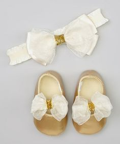 This Gold Bow Booties & Headband by So Dorable is perfect! #zulilyfinds