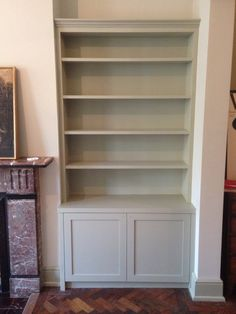 Alcove shelving and cupboard by Fine Balance Carpentry.