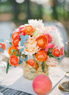 Amazing centerpiece!! Photography: Justin DeMutiis Photography - justindemutiisphotography.com Read More: http://www.stylemepretty.com/2014/03/28/peach-wedding-inspiration-full-of-color/