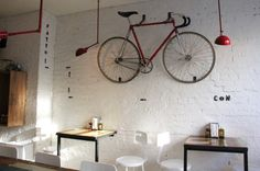 and we will hang d's bike on the wall: Red Bicycle on White Painted Brick Wall at Pizzeria Farina, Remodelista