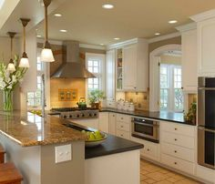 Breakfast bar higher than counter/arched window to family room